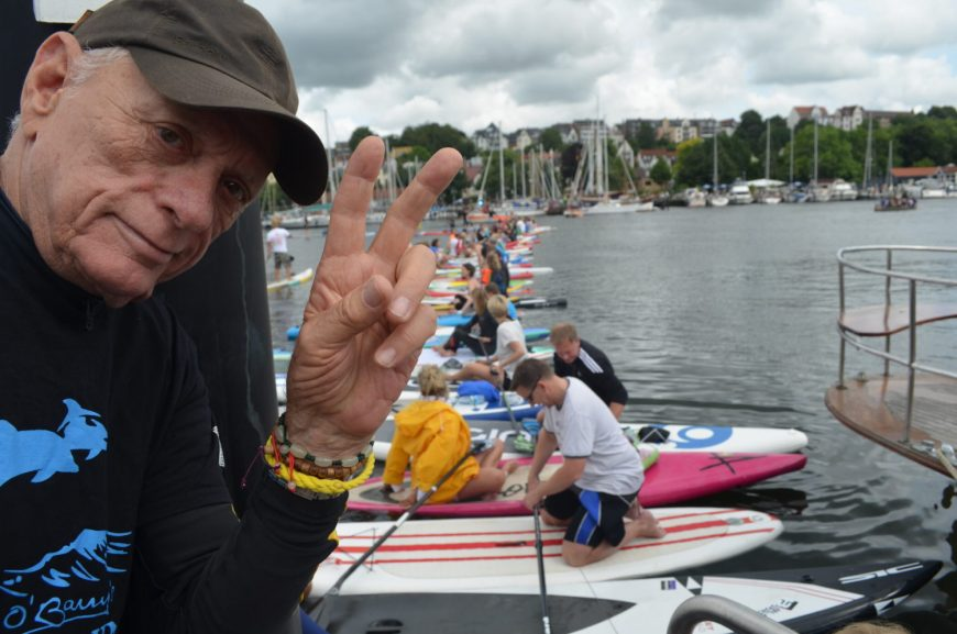 Ric O'Barry successfully crosses Flensburg harbor via 200 standup paddle boards to bring awareness to Taiji dolphin slaughter