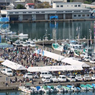 Taiji Whale Festival - banger boats docked in harbor and vendors selling dolphin meat, 11-6-16