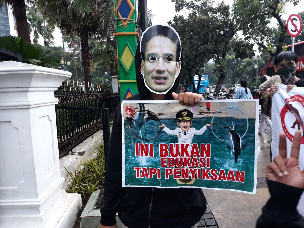 Local Indonesian activists protest the traveling dolphin circus.