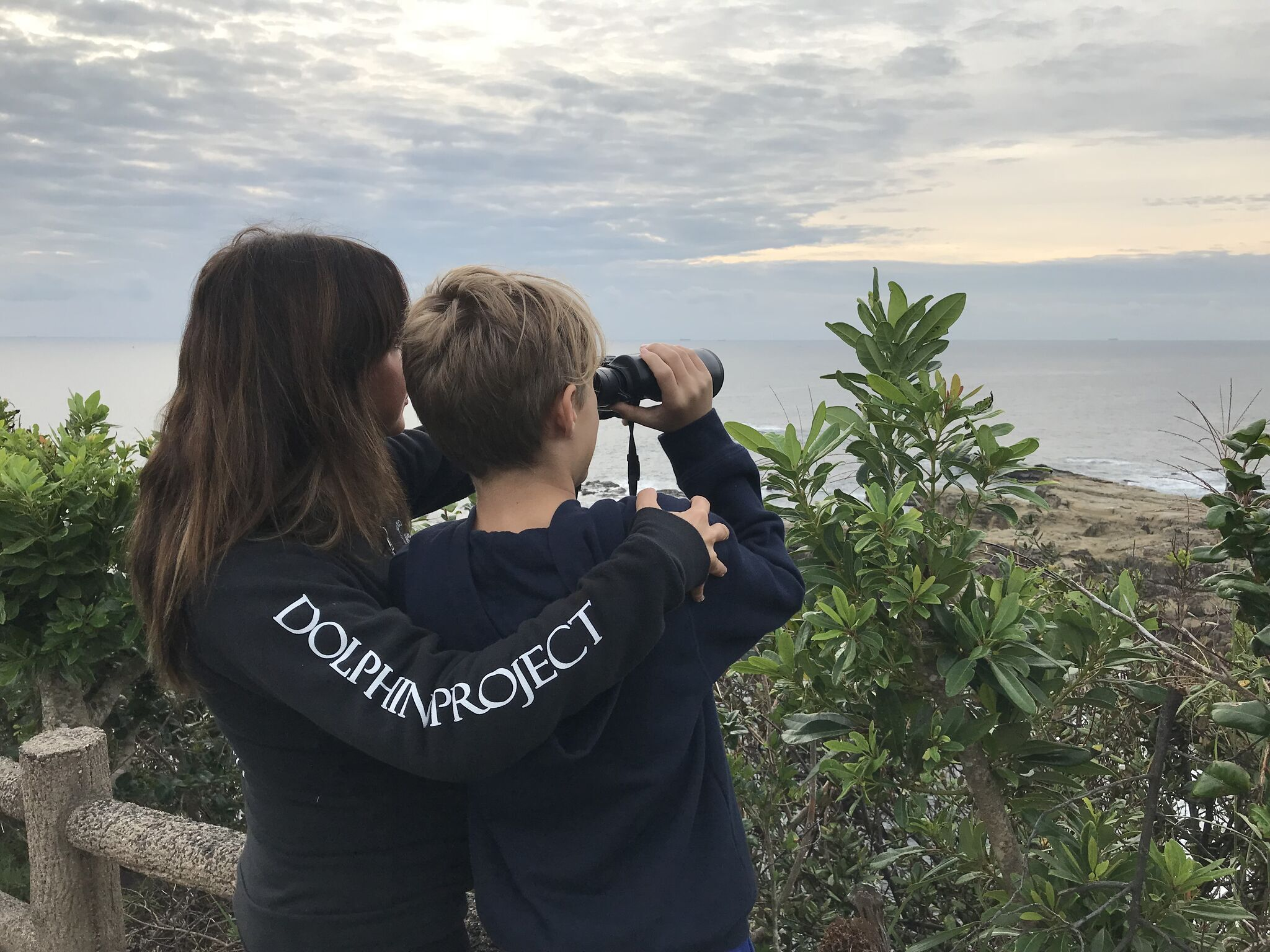 Dolphin Project Cove Monitors scan the horizon for dolphin hunting boats, Taiji, Japan.