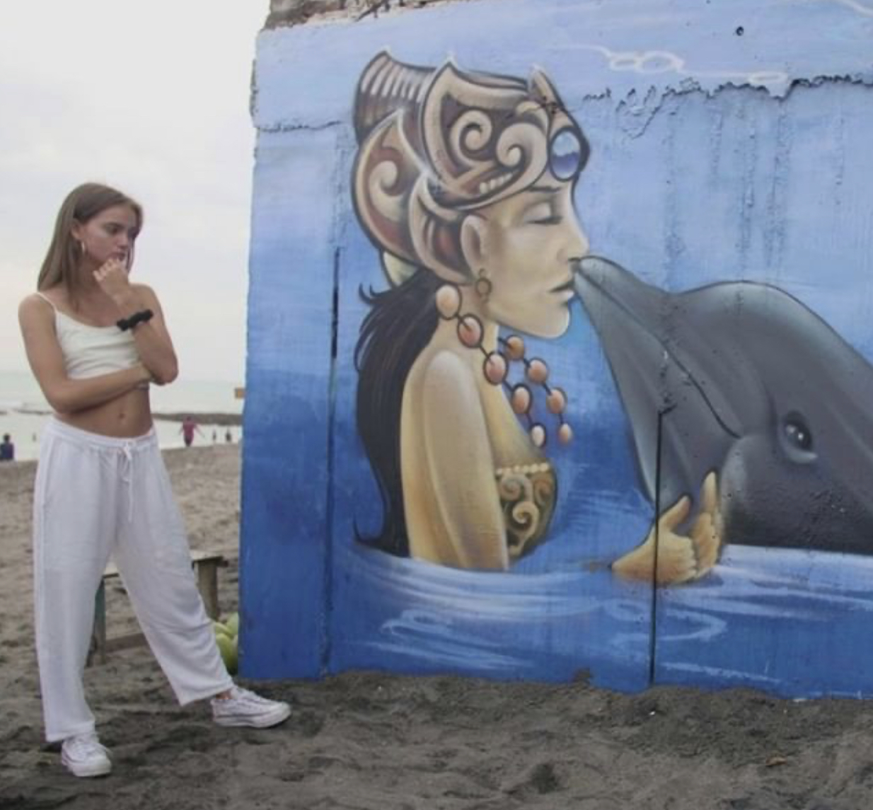 Inka Williams, Ambassador of our #FreeBaliDolphins campaign stands beside a #FreeBaliDolphins mural, Bali, Indonesia.