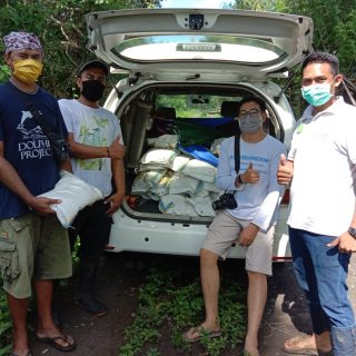 Our team helps to distribute masks and food to local villagers in need, Bali, Indonesia